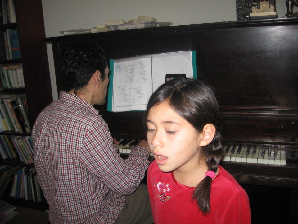 Destiny singing as Dad plays the piano.